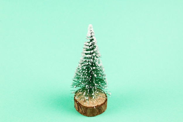 Christmas tree on a green background. copy space.