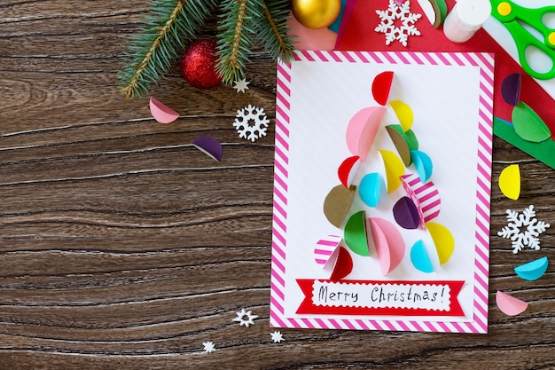 Christmas tree greeting card handmade project of childrens creativity handicrafts top view