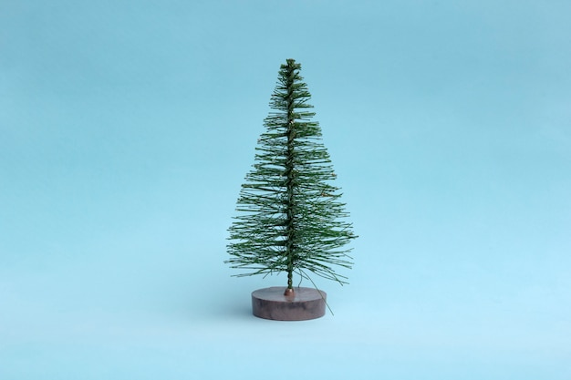Christmas tree on light background in minimal style.