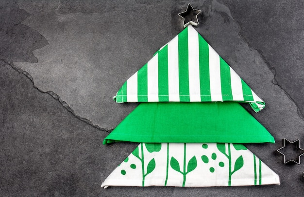 Christmas tree made from kitchen napkins and cookies star.