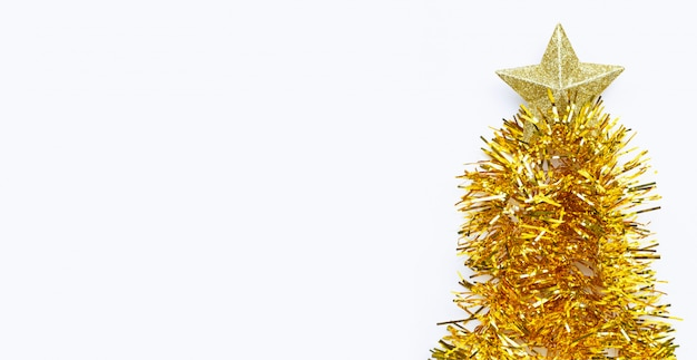 Christmas tree made of  golden christmas garland  with star on white background.