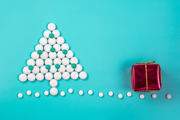 Christmas tree made of pills. new year in medicine, pharmacy and drugstore