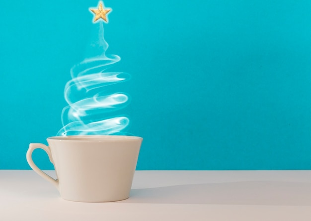 Christmas tree made steaming cup of coffee