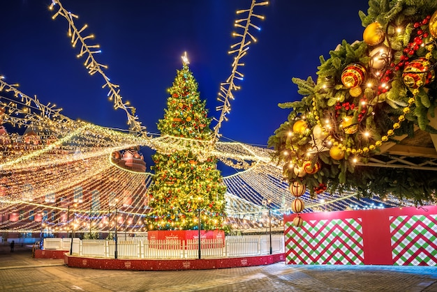 Christmas tree on manezh square in moscow and christmas-tree decorations in night-time lighting