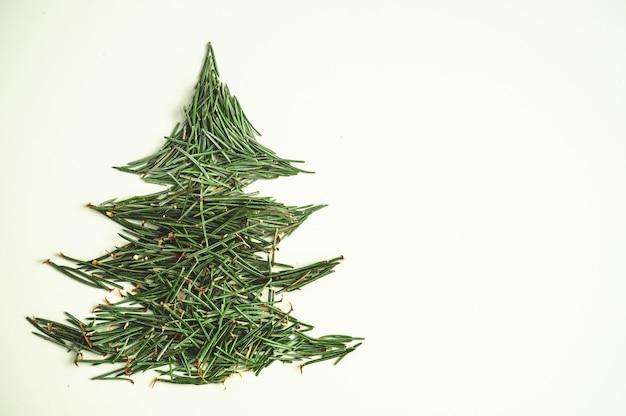 Christmas tree needles on the white background