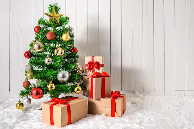 Christmas tree and ornaments with gifts boxes