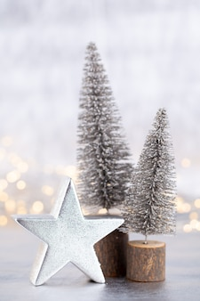 Christmas tree on silver, bokeh background.