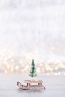 Christmas tree on silver, bokeh background