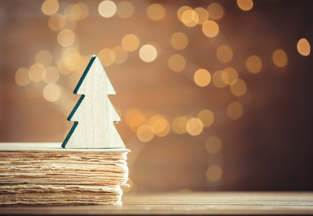 Christmas tree toy and old books Premium Photo