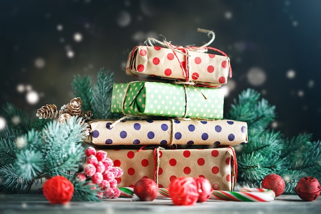 Christmas tree toys, christmas tree and christmas gifts on dark wooden background