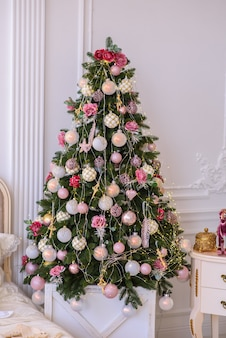 Christmas tree in a white cozy room