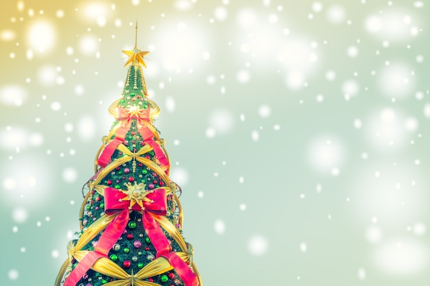 Christmas tree with big bows on a blue background with lights