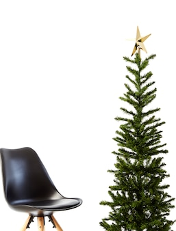 Christmas tree with black chair