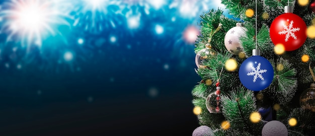 Christmas tree with bokeh light on fireworks background at night festival