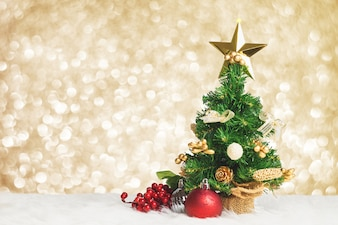 Christmas tree with cherry and decorative ball on gold background