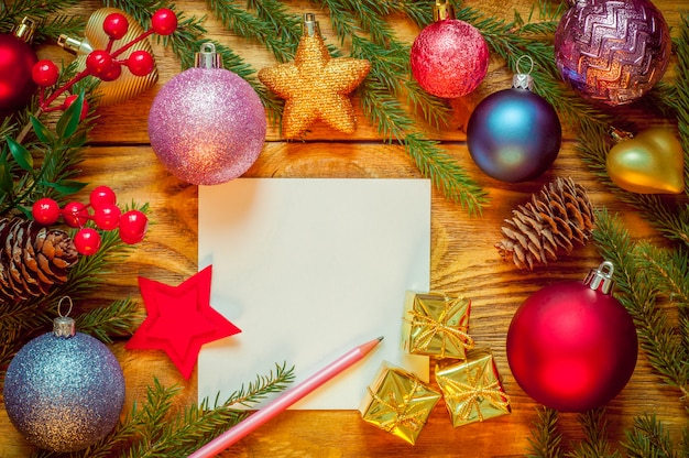 Christmas tree with decoration on a wooden board. christmas toy. new year. sheet for congratulations.