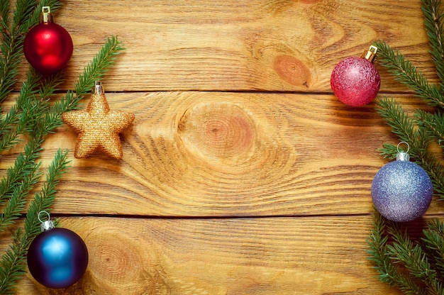 Christmas tree with decoration on a wooden board. christmas toy. new year
