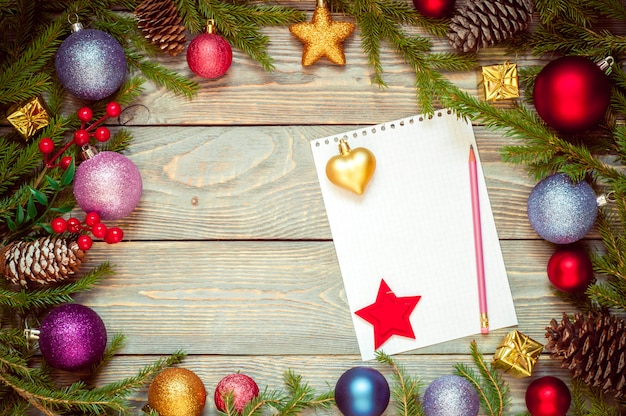 Christmas tree with decoration on a wooden board