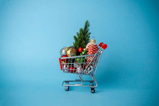 Christmas tree with decorations in a supermarket cart