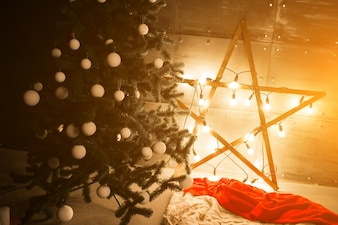 Christmas tree with lights and star in a loft room