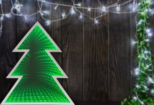 크리스마스 트리 조명과 함께 나무 배경