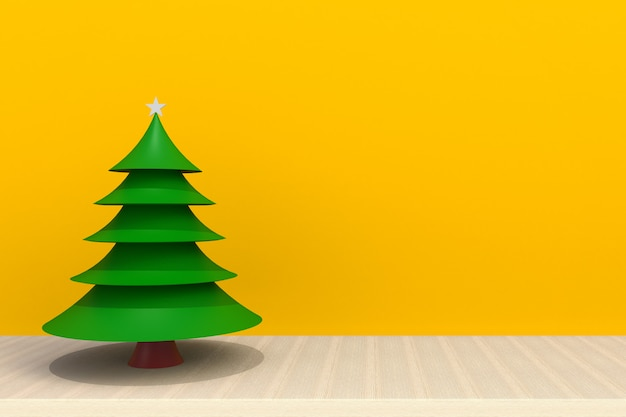 Christmas tree on wooden table in front of yellow background