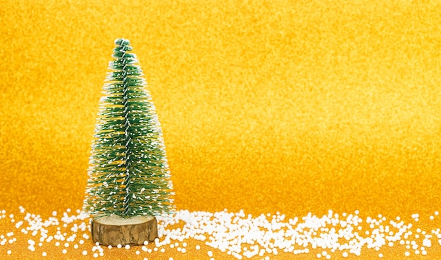 Christmas trees on a bright golden background.