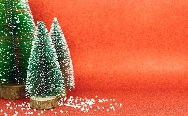 Christmas trees on a bright red background