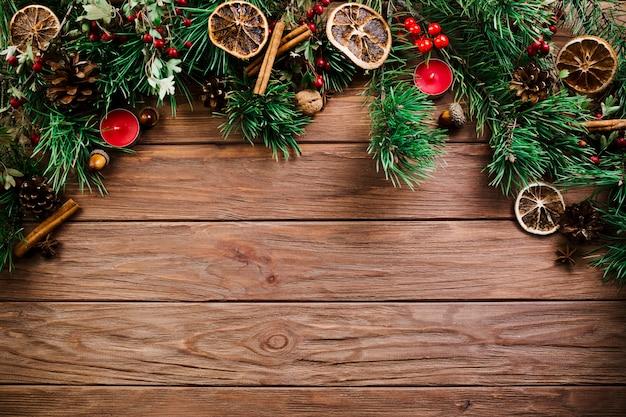 Christmas twig on wooden board