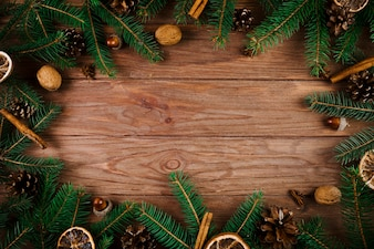 Christmas twigs and walnuts on wooden desk