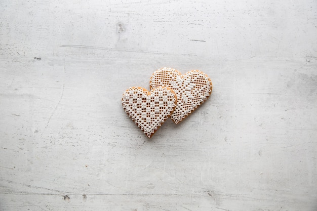 Christmas or valentine heart with ornaments on white background.