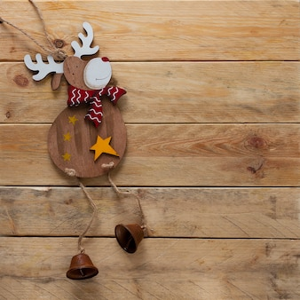 Christmas wallpaper, plywood topper reindeer, on a wooden background, horizontal, no people,