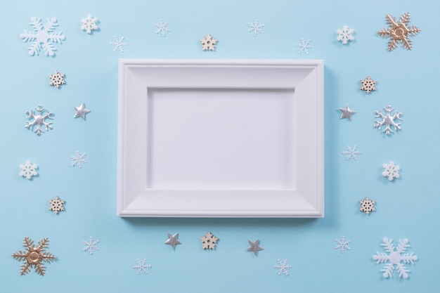 Christmas and winter concept. snowflake with photo frame on light blue background.
