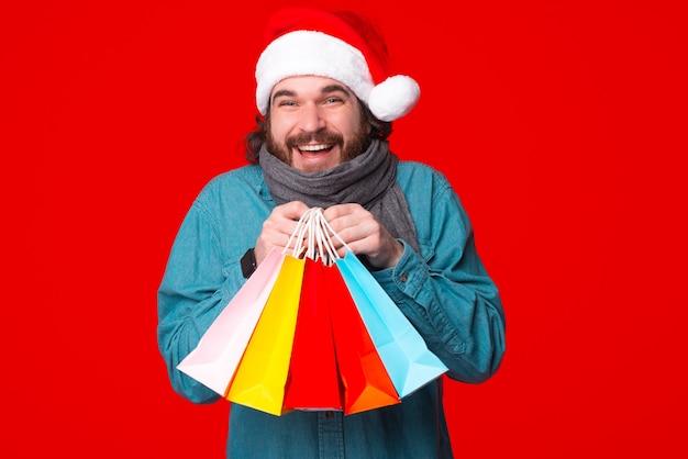 Christmas winter holidays celebration. man hold shopping bags