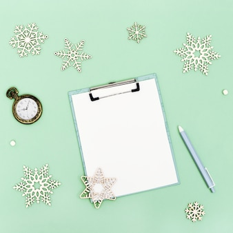 Christmas wishlist or santa letter on mint colored paper background