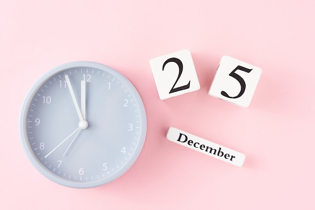 Christmas  with alarm clock on pink
