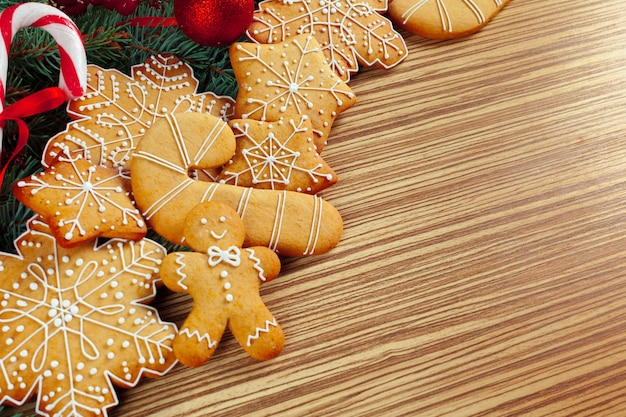 Christmas  with branch of fir tree decorated by gingerbread.