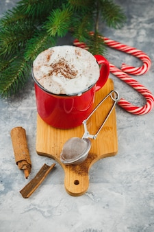 Christmas with hot chocolate, spices, candy cane, fir tree and cookies.