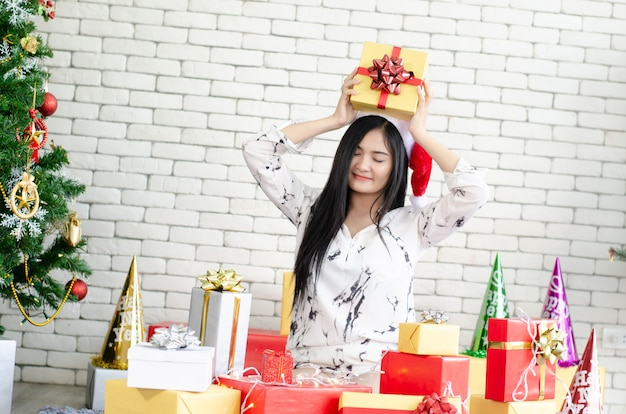Christmas women enjoy with christmas gift box