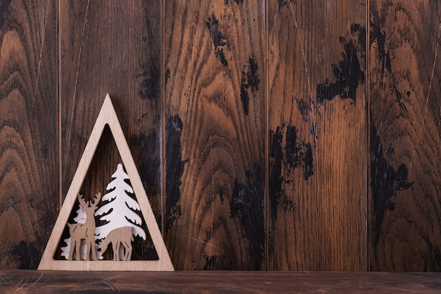 クリスマスの木製の背景とコピースペースの装飾