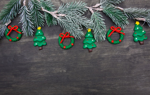 Christmas wooden background with christmas tree and red decorations.