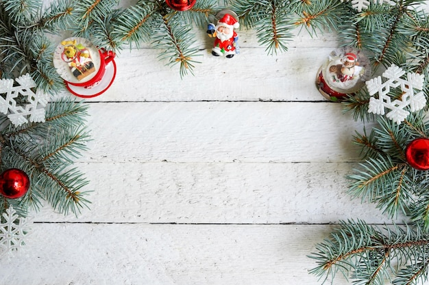 Christmas wooden background with decorative fir branches and toys, copy space