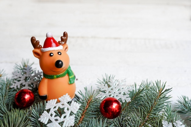 Christmas wooden background with deer and fir tree . view with copy space