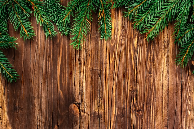Christmas wooden background with fir tree branches.