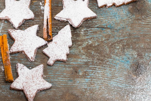 Christmas wooden background with gingerbread cookies. top view with copy space for your greetings.
