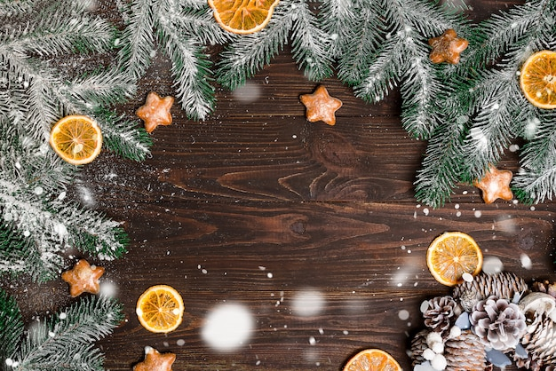 Christmas wooden background with snow fir tree. view with copy space.
