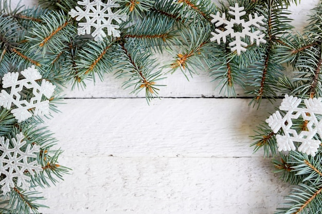Christmas wooden background with snow fir tree . view with copy space