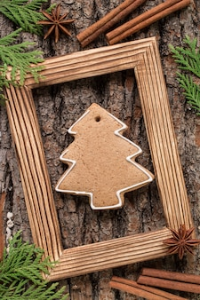 Christmas wooden frame with gingerbread cookies. top view
