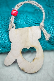 Christmas wooden toys on the of the sweater closeup