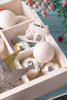 Christmas wooden tray with toys. antique stars and balls on wooden table. close up
